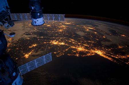 Nighttime view from the International Space Station shows the Atlantic coast of the United States in this NASA handout image dated February 6, 2012. REUTERS/NASA/Handout