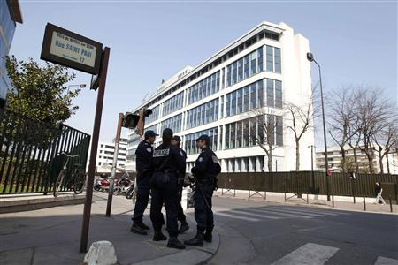 Police stand opposite the French domestic intelligence agency (DCRI) headquarters in Levallois-Perret, near Paris, March 24, 2012. Abdelkader Merah, elder brother of Mohamed Merah who died in an assault by special forces police in Toulouse on Thursday, and his girlfriend were transfered to the DCRI from Toulouse for further questioning about the massacre, and would be brought before a judge to decide whether there are grounds for opening legal proceedings over possible links with Mohamed's attacks. REUTERS/Gonzalo Fuentes