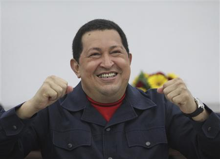 Venezuela's President Hugo Chavez reacts while speaking in a video conference with Argentina's counterpart Cristina Fernandez de Kirchner at the Miraflores Palace in Caracas March 20, 2012.REUTERS/Miraflores Palace/Handout
