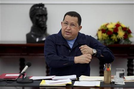 Venezuela's President Hugo Chavez speaks during the Council of Ministers at the Miraflores Palace in Caracas March 24, 2012. REUTERS/Miraflores Palace/Handout
