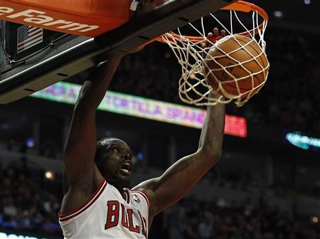 Chicago Bulls' Luol Deng makes a basket against the Toronto Raptors during their NBA basketball game in Chicago March 24, 2012. REUTERS/Jim Young