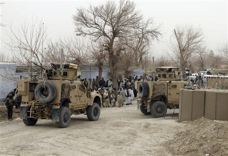 U.S. armoured vehicles are parked outside a U.S. base in Panjwai district Kandahar province, March 11, 2012. REUTERS/Ahmad Nadeem