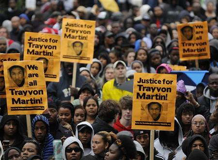 People gather at a ''Stand Up for Trayvon Martin'' rally in Washington March 24, 2012. REUTERS/Jonathan Ernst