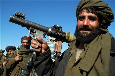 A Taliban militant poses for a picture after joining the Afghan government's reconciliation and reintegration program, in Herat January 30, 2012. REUTERS/Mohammad Shoiab