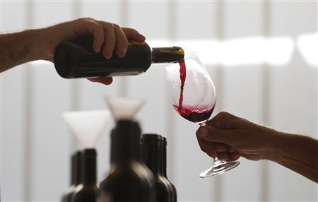 A man tests red wine in the Tenuta dell'Ornellaia estate in Castagneto Carducci, in Tuscany, September 20, 2011. REUTERS/Tony Gentile