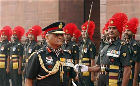 India's newly appointed army Chief General Vijay Kumar Singh inspects the guard of honour after taking over the charge in New Delhi April 1, 2010. REUTERS/Adnan Abidi/Files
