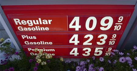 Gas prices are seen posted at a petrol station in Los Angeles February 22, 2011. REUTERS/Gary Hershorn