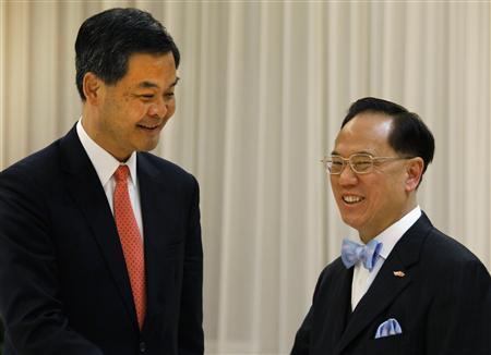 Hong Kong chief executive elect Leung Chun-ying (L) smiles as he meets Hong Kong chief executive Donald Tsang at the Chief Executive's Office in Hong Kong March 26, 2012. REUTERS/Vincent Yu/Pool