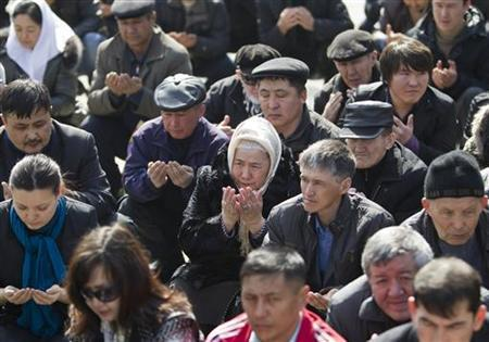 People pray during an opposition rally in Almaty, March 24, 2012. REUTERS/Shamil Zhumatov