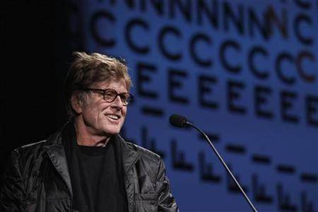 Robert Redford, founder of the Sundance Institute, welcomes the audience before the opening night premiere of the documentary ''The Queen Of Versailles'' to begin the Sundance Film Festival in Park City, Utah January 19, 2012. REUTERS/Lucas Jackson