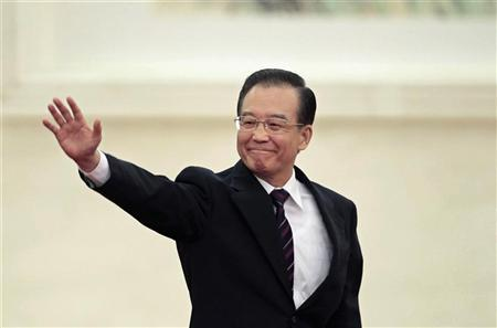 China's Premier Wen Jiabao waves as he arrives for a news conference after the closing ceremony of the National People's Congress (NPC) at the Great Hall of the People in Beijing, March 14, 2012. REUTERS/Jason Lee