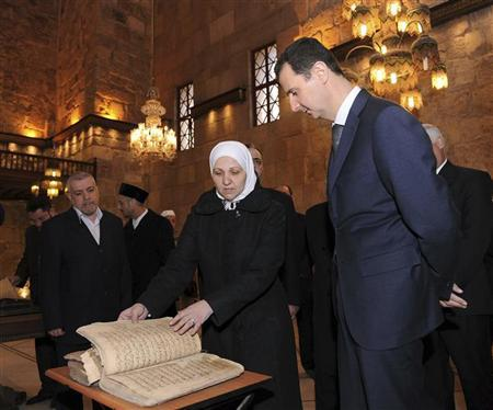 A handout photo distributed by Syrian News Agency (SANA) shows Syria's President Bashar al-Assad (R) during his visit to the Umayyad Mosque in Damascus March 20, 2012, to inspect the printed and audio standard copy of the Koran. REUTERS/SANA/Handout
