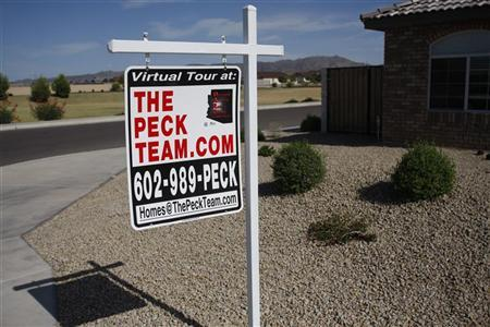 A real estate sales sign sits outside of a house for sale in Phoenix, Arizona June 2, 2009. REUTERS/Joshua Lott