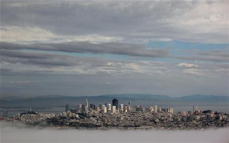 The skyline of San Francisco is seen as it rises above the fog, from the Marin Headlands in Sausalito, California March 21, 2012. REUTERS/Robert Galbraith