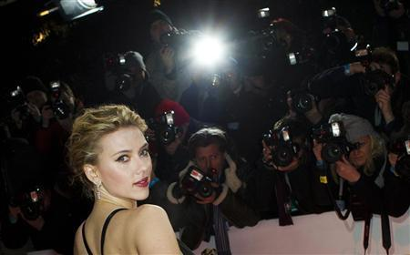 U.S. actress Scarlett Johansson poses for pictures as she arrives on the red carpet for the ''Goldene Kamera'' (Golden Camera) awards ceremony in Berlin, February 4, 2012. REUTERS/Thomas Peter
