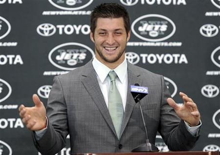 New York Jets quarterback Tim Tebow speaks at a news conference introducing him as a Jets at the team's training center in Florham Park, New Jersey March 26, 2012. REUTERS/Ray Stubblebine
