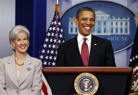 U.S. President Barack Obama smiles before he makes a statement next to Secretary of HHS Kathleen Sebelius about contraceptive care in the press room of the White House in Washington, February 10, 2012. REUTERS/Larry Downing