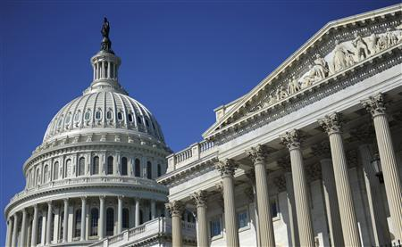 The U.S. Capitol dome and U.S. Senate (R) in Washington, August 2, 2011. REUTERS/Jonathan Ernst