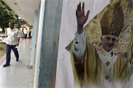 A poster of Pope Benedict XVI is seen on a street in Havana March 26, 2012. Pope Benedict arrives in Cuba on Monday for a three-day visit that has fueled aspirations for deeper economic and political change on the communist-run island and which the Roman Catholic Church hopes will spark a faith revival. REUTERS/Enrique de la Osa
