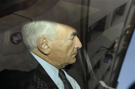 Former IMF chief Dominique Strauss-Kahn leaves his apartment in a car as he is driven to the financial brigade in Paris in this September 29, 2011 file photo. REUTERS/Gonzalo Fuentes/Files