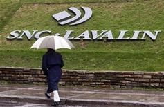 A pedestrian walks past the SNC-Lavalin Group Inc., headquarters in Montreal, May 7, 2009. SNC-Lavalin Group Inc reported a nearly 10 percent increase in first-quarter profit on Thursday, as the big Canadian engineering and construction company recorded larger gains from infrastructure concession investments such as toll roads. REUTERS/Christinne Muschi