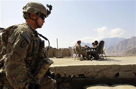 A U.S. Army soldier from Bravo Company, 2nd Batallion, 35th Infantry Division, Task Force Cacti stands guard as his comrades have a meeting with Afghan National Army soldiers at an Afghan military base in Marawara district in Kunar province, eastern Afghanistan March 14, 2012. REUTERS/Erik De Castro