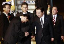 Japan's Prime Minister Yoshihiko Noda (2nd R) is being greeted as he arrives at Gimpo airport in Seoul for the 2012 Seoul Nuclear Security Summit March 26, 2012. REUTERS/Wally Santana/Pool