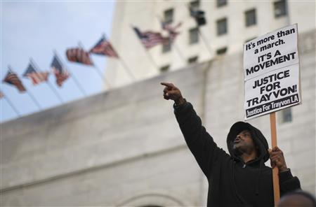 Protesters rally on the steps of City Hall during a Million Hoodies March, to protest the failure of police to arrest a Florida neighborhood watch volunteer for shooting to death an unarmed black teenager, Trayvon Martin, in Los Angeles, California, March 26, 2012. REUTERS/David McNew