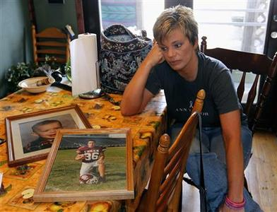 Melissa Himmelheber, 43, shows pictures of her son, C. J. Coomer, who died of an Opana overdose last July at the age of 24 in Austin, Indiana, at her home in Scottsburg, Indiana, March 19, 2012. REUTERS-John Sommers II