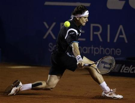 David Ferrer of Spain hits a return to compatriot Fernando Verdasco during the men's singles final match at the Acapulco International Mexican Open tennis tournament in Acapulco March 3, 2012. REUTERS/Henry Romero