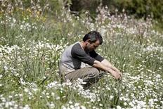 "Dimitris Stamatakos, 36, sits in a field on land he is renting near his home in the village of Krokeae in the Peloponesse area of Greece, March 18, 2012. Before the crisis Stamatakos was able to make a living by selling olives that he farmed on the land he owns, now he is forced to labour for neighbouring farms and do odd jobs to earn his living. The crisis is also putting a strain on his marriage to his wife Voula, 32. He says, ""I row with my wife a lot about money. She thinks I should be doing more. What more can I do? I'm just getting by."" Picture taken March 18, 2012. REUTERS/Cathal McNaughton"