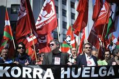 "Basque Country Secretary-Generals of two of Spain's largest trade unions, Unai Sordo of Comisiones Obreras, (CCOO) (C) and Damaso Casado of the General Union of Workers (UGT) (2nd R) walk behind a banner reading: ""Strike"" during a march in central Bilbao March 27, 2012. Trains, buses and air traffic will be severely limited in Spain on Thursday during a general strike called by unions to protest against high unemployment and changes to labour laws that will make it cheaper for companies to lay off employees. REUTERS/Vincent West"