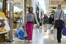 A woman carries shopping bags at South Park mall in Charlotte, North Carolina November 25, 2011. REUTERS/Chris Keane