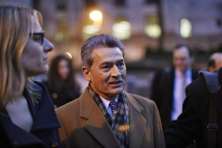 Former McKinsey chief and ex-Goldman Sachs director Rajat Gupta (C) exits the Manhattan Federal Court after attending a pre-trial hearing on insider-trading charges in New York January 5, 2012. REUTERS/Eduardo Munoz/Files