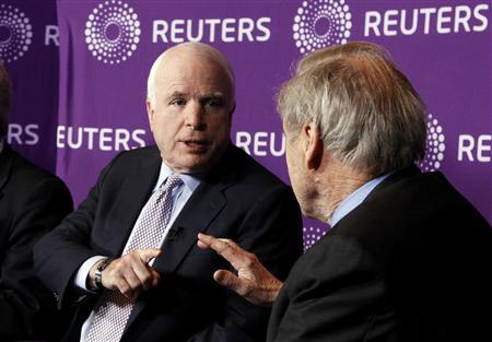 Former Republican presidential nominee U.S. Senator John McCain (C) talks about the U.S. Supreme Court decision in the ''Citizens United'' case as he talks with moderator and Reuters Editor-at-Large Sir Harold Evans (R) during a panel discussion called ''Politics, Inc.'' on U.S. campaign financing and the influence of money in politics hosted by Reuters at the Newseum in Washington, March 27, 2012. REUTERS/Jim Bourg