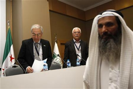 Syrian National Council members Samir Nashar (L) and George Sabra (2nd L) arrive for a news conference after their meeting in Istanbul March 27, 2012. REUTERS/Murad Sezer