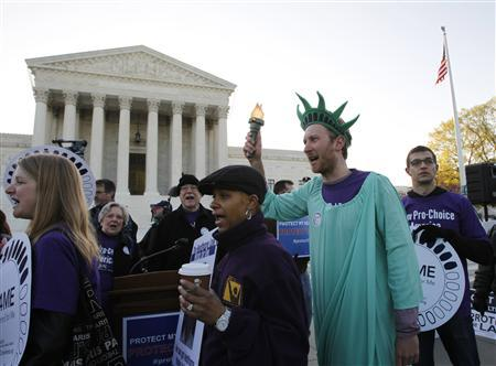Supporters of U.S. President Barack Obama's health care reform rally outside the Supreme Court in Washington, March 27, 2012, during the second day of legal arguments over the Affordable Care Act. REUTERS/Jason Reed