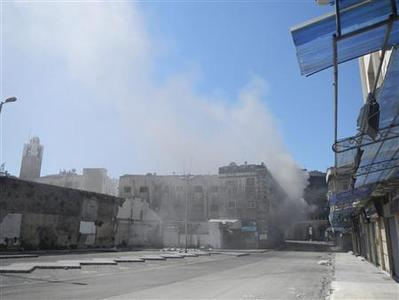 Smoke rises from downtown Homs March 21, 2012, in this handout released to Reuters on March 27, 2012. REUTERS/Abu al-Zain Al-Homsi/Shaam News Network/Handout