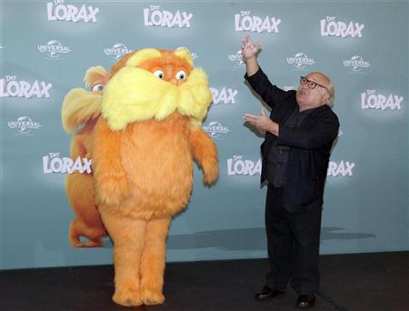 U.S. actor Danny DeVito poses with 'The Lorax' character, during a photocall to promote the 3-D animated film ''Dr. Seuss' The Lorax'' in Berlin March 5, 2012. REUTERS/Tobias Schwarz