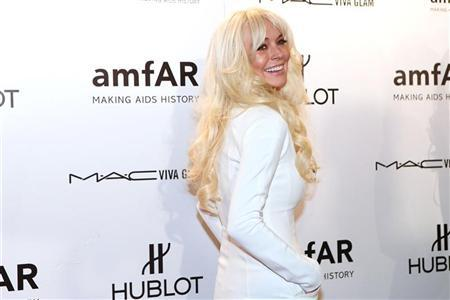 Actress Lindsay Lohan arrives at the annual American Foundation for AIDS Research (amfAR) New York Gala at Cipriani's on Wall Street in New York, February 8, 2012. REUTERS/Andrew Burton