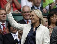 Former Wimbledon champion, Martina Navratilova, waves as she arrives on Centre Court for the match between Caroline Wozniacki of Denmark and Jarmila Gajdosova of Australia at the Wimbledon tennis championships in London June 25, 2011. REUTERS/Stefan Wermuth
