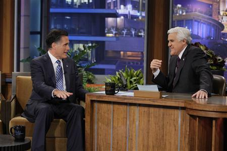 U.S. Republican presidential candidate Mitt Romney (L) talks with host Jay Leno during a taping of ''The Tonight Show with Jay Leno'' in Burbank, California in this handout image released by NBC March 27, 2012. REUTERS/Paul Drinkwater/NBC