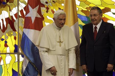 Pope Benedict XVI (L) is received by Cuba's President Raul Castro at the Revolution Palace in Havana March 27, 2012. REUTERS/Ismael Francisco/Cubadebate/Handout
