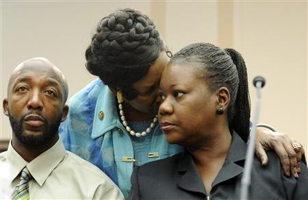 Tracy Martin (L) and Sybrina Fulton (R), parents of Florida shooting victim Trayvon Martin, are comforted by U.S. Representative Sheila Jackson Lee (D-TX) (2nd R) as they speak at a public forum on their son's case, on Capitol Hill in Washington, March 27, 2012. Trayvon, 17, was shot on February 26 by George Zimmerman, a neighborhood watch volunteer in a suburb of Orlando, Florida. REUTERS/Jonathan Ernst