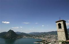 "A general view shows the southern Swiss town of Lugano and the ""Monte San Salvatore"" mountain in this July 30, 2007 file photograph. REUTERS/Christian Hartmann/File"