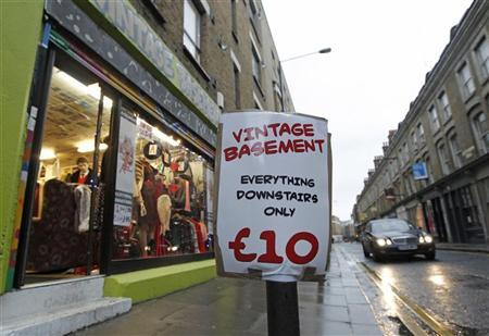 A shop advertises deals in its bargain basement, in London January 25, 2011. REUTERS/Luke MacGregor