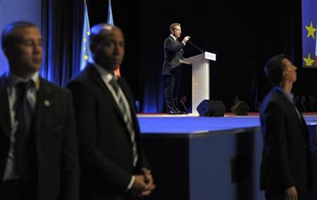 Bodyguards stand near the stage where France's President and UMP party candidate for the 2012 French presidential elections Nicolas Sarkozy delivers a speech at a political rally in Saint-Herblain, near Nantes, March 27, 2012. REUTERS/Philippe Wojazer