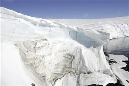 Ice melt shows through at a cliff face at Landsend on the coast of Cape Denison in Antarctica December 14, 2009. REUTERS/Pauline Askin