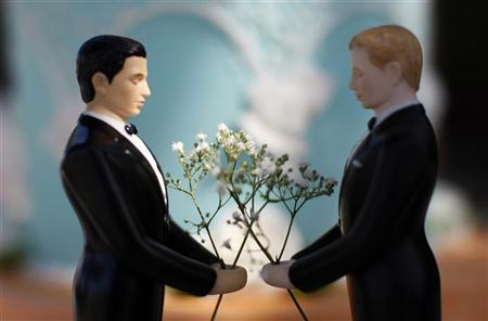 A same-sex wedding cake topper is seen outside the East Los Angeles County Recorder's Office on Valentine's Day during a news event for National Freedom to Marry Week in Los Angeles, California February 14, 2012. REUTERS/David McNew