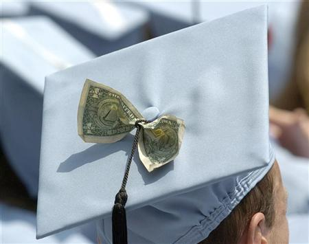 Graduates celebrate receiving a Masters in Business Administration from Columbia University during the year's commencement ceremony in New York in this May 18, 2005 file photo. FINANCIAL/GRADUATES REUTERS/Chip East/Files